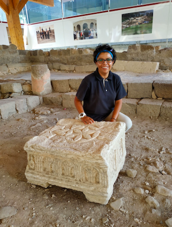 Fig. 1. The Magdala Stone (replica) and Marcela Zapata-Meza, the head of the Mexican Universidad Anahuac expedition. Photograph by the author, 2018.