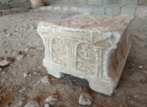 Fig. 9. A narrow side (back?) of the Magdala Stone (replica) decorated with two rosettes and arches. Photograph by the author, July 2018.