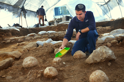 Fig. 3: Ballista and sling stones in-situ at the Russian Compound excavations, Jerusalem. Photo by Yoli Shwartz, IAA. Courtesy of Kfir Arbiv and IAA.